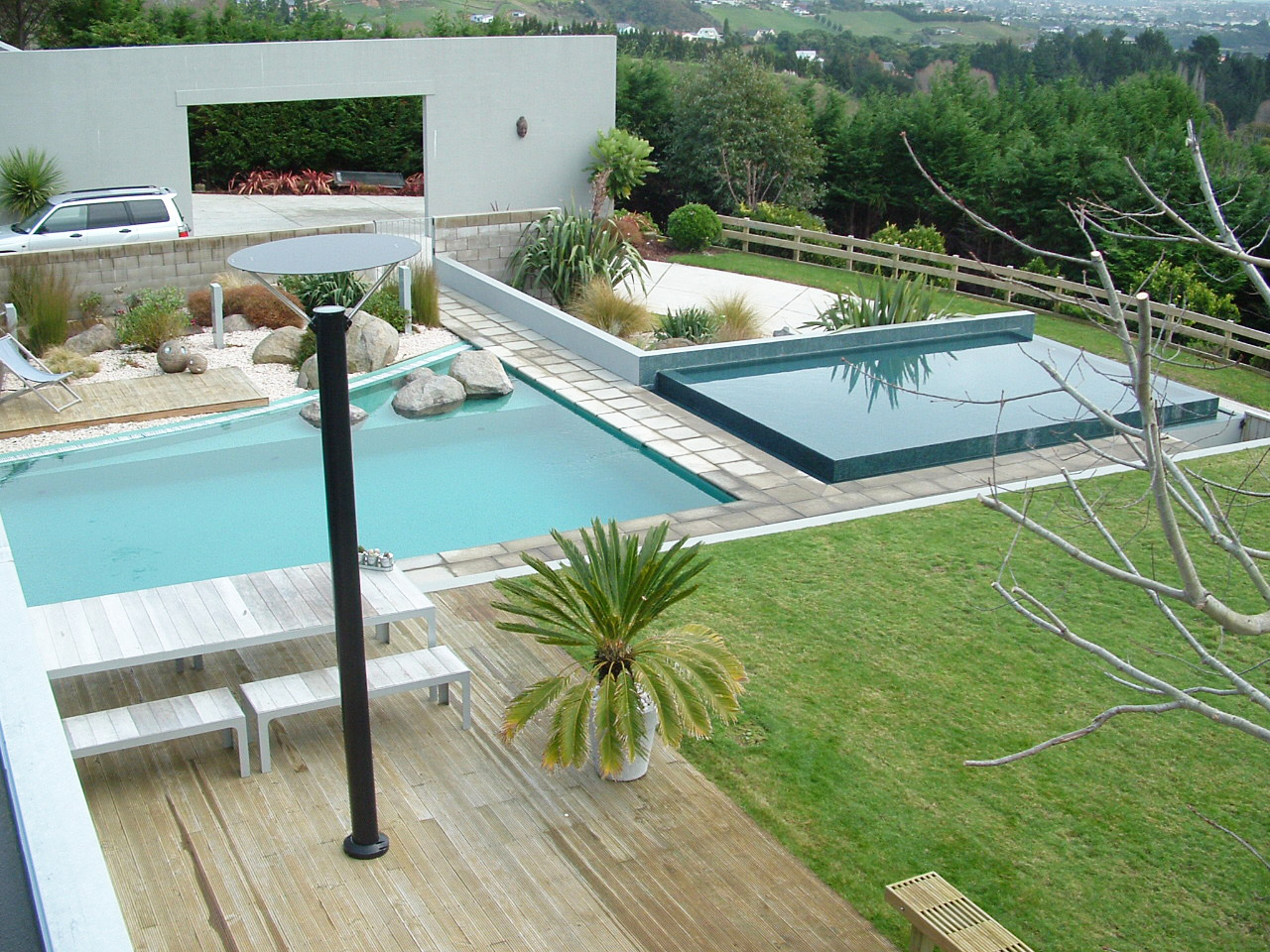 Modern Main Pool With Negative Or Horizon Edge Pool Feature